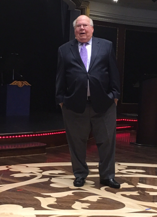 Verne Lundquist on Stage at Sea